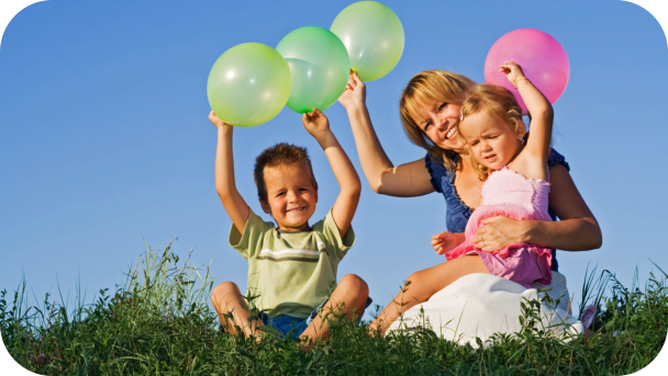 a teacher and kids playing balloon