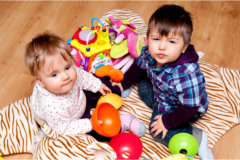 babies playing toys