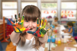 a girl with paint on her hands