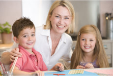 a teacher, a boy and a girl smiling
